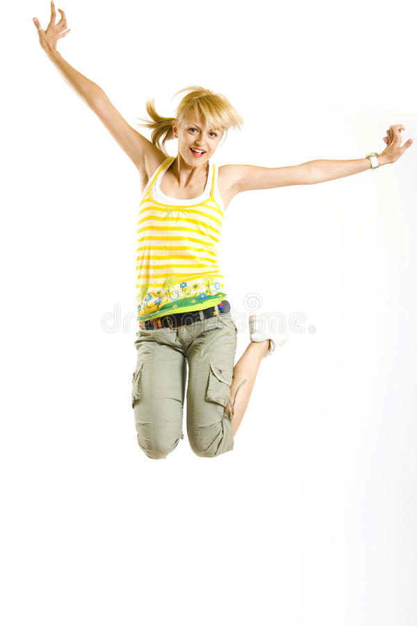 Casual girl jumps in the air stock photography