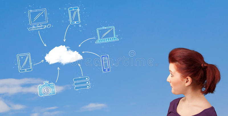 Casual girl looking at cloud computing concept on blue sky. Casual young girl looking at cloud computing concept on blue sky royalty free stock photography
