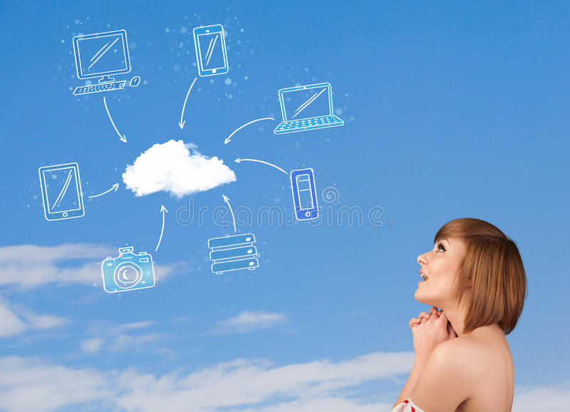 Casual girl looking at cloud computing concept on blue sky. Casual young girl looking at cloud computing concept on blue sky royalty free stock images