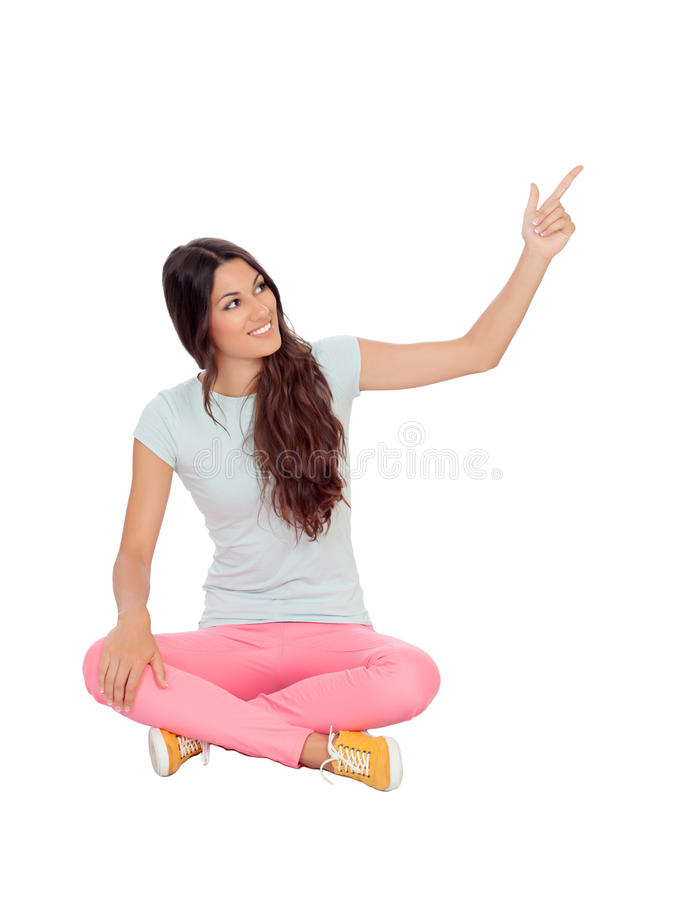 Download Casual Girl Sitting On The Floor Pointing Something Stock Photo - Image of people, attractive: 32495126