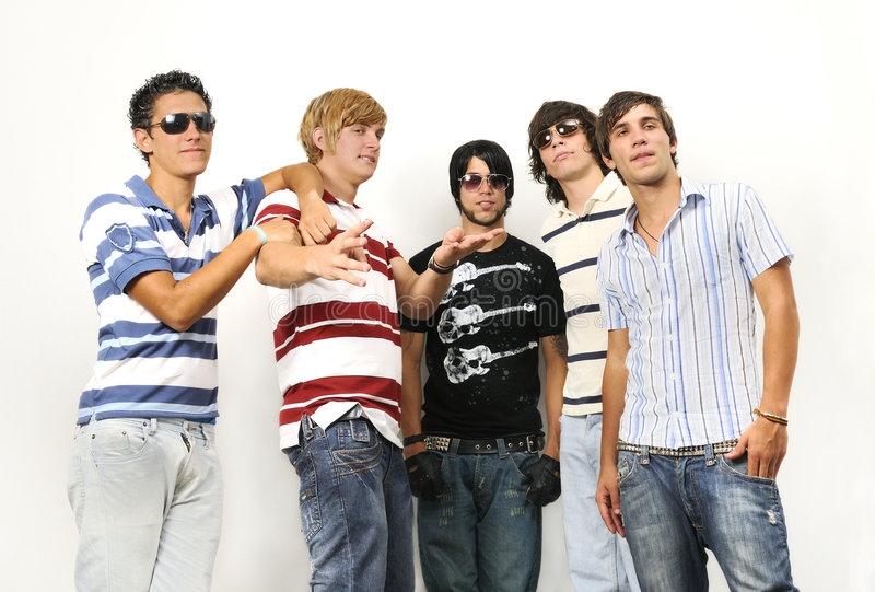 Casual group of friends. Portrait of young trendy teenager group standing isolated royalty free stock photo