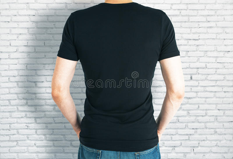 Casual guy in black shirt back royalty free stock photo