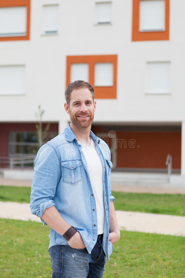 Casual guy with a denim shirt relaxed. In the street royalty free stock images