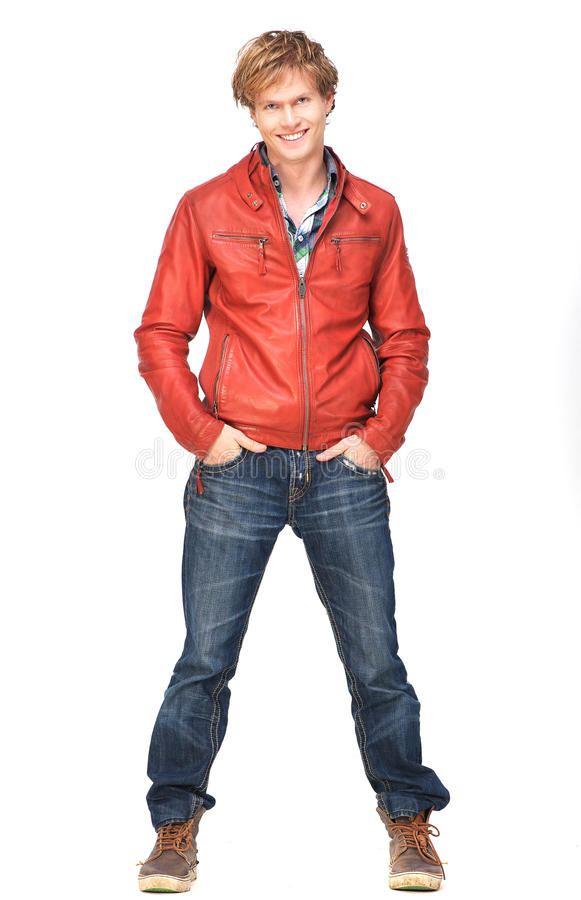 Casual Guy Smiling Full Length Portrait. Casual guy smiling with hands in pocket. Full length portrait isolated on white background royalty free stock images