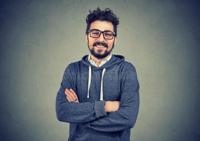 Casual handsome man smiling at camera stock photo
