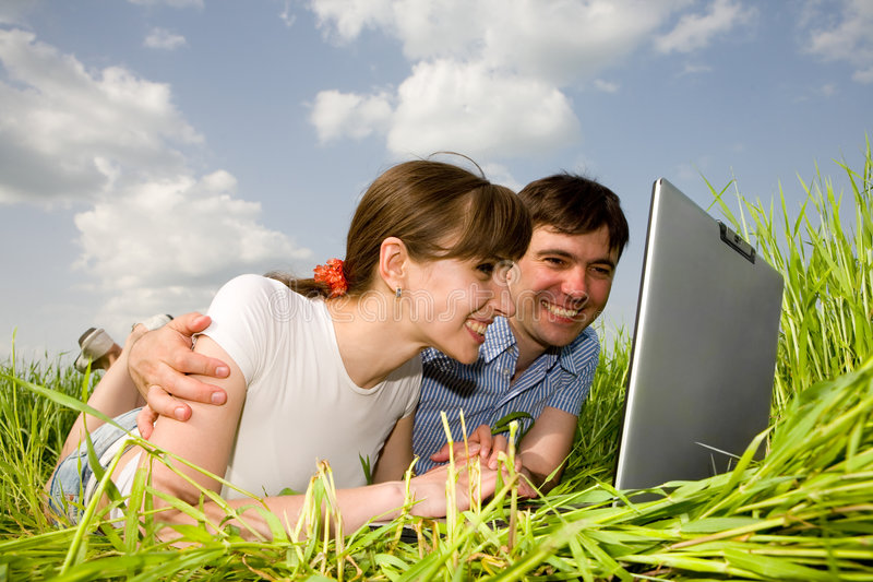 Download Casual Happy Couple On A Laptop Computer Stock Image - Image: 8847169