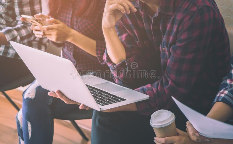 Casual home worker sitting in a row in meeting royalty free stock photos