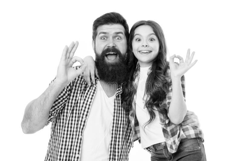 Casual and informal. Bearded man and cute girl in casual outfit gesturing ok. Happy father and small child in casual stock photography