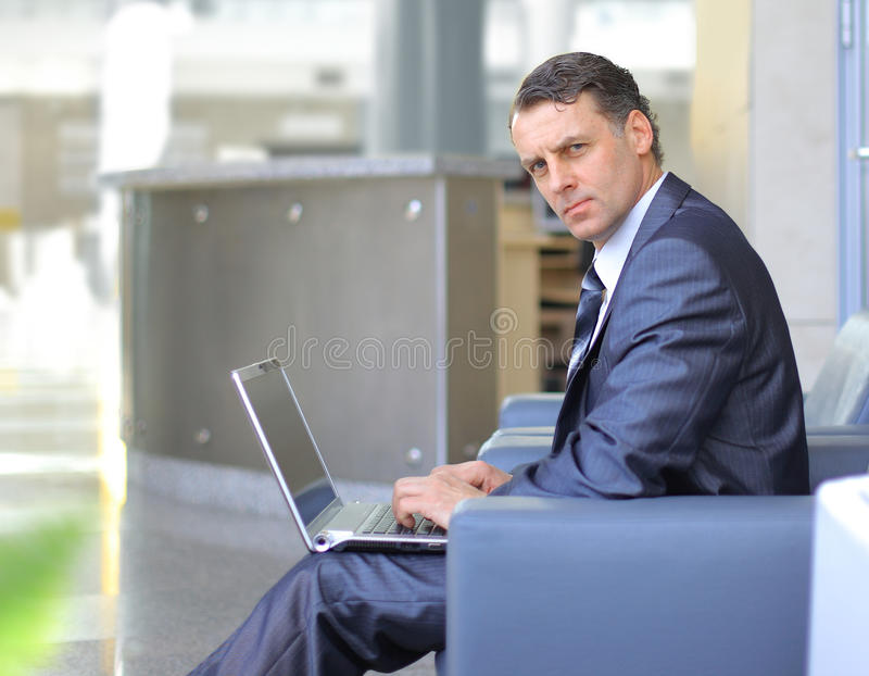 Download Casual looking businessman stock image. Image of laptop - 19536617