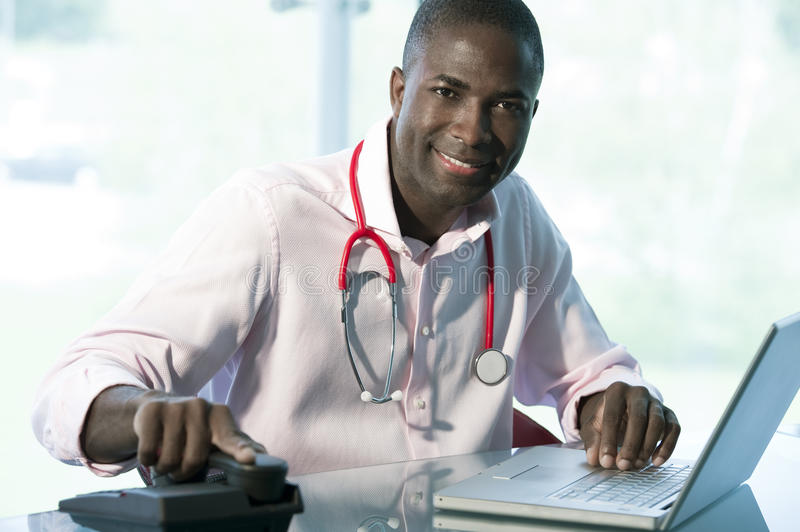 Casual male doctor stock photos