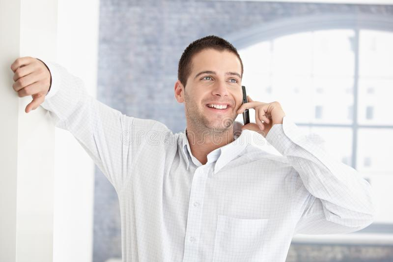 Download Casual Man Chatting On Mobile Smiling Stock Photo - Image: 18382336