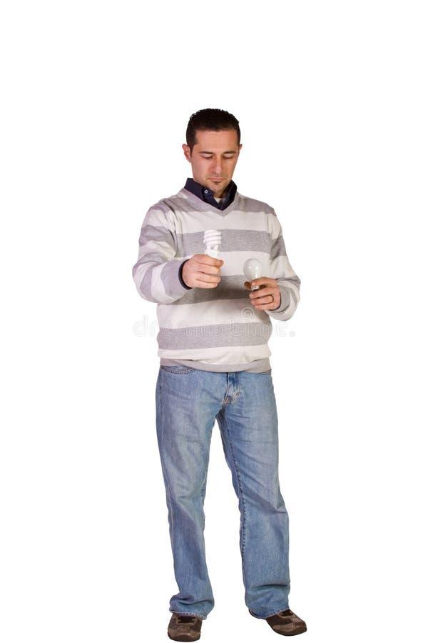 Casual Man Choosing Green Friendly Bulb stock photo