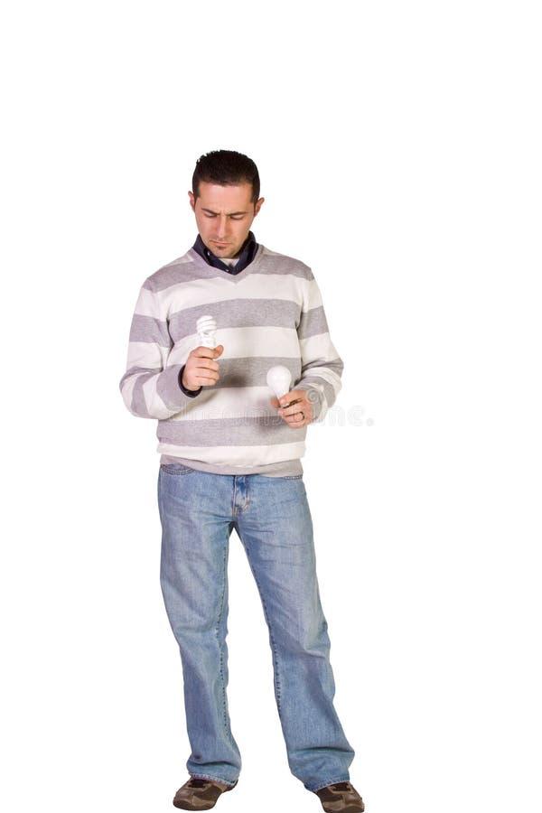 Casual Man Choosing Green Friendly Bulb stock photography