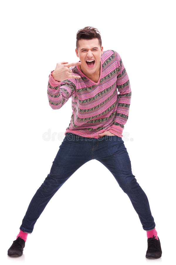 Download Casual  Man Doing A Rock And Roll Symbol Stock Photo - Image: 23362246