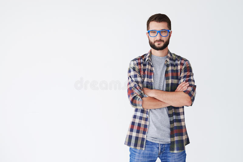 Casual man in glasses standing with arms folded royalty free stock photo
