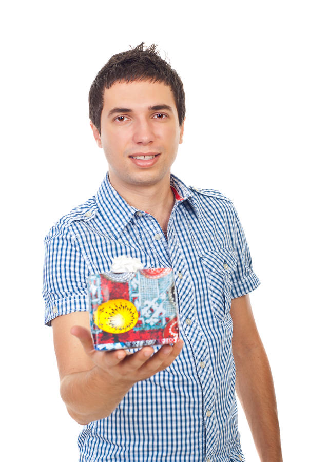Casual man holding gift royalty free stock images