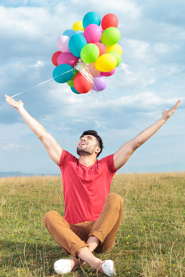 Download Casual Man Holds Balloons With Open Arms Stock Image - Image: 33178445