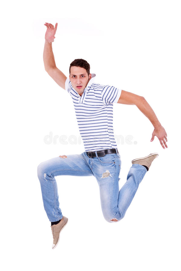 Casual man jumping of joy royalty free stock photo