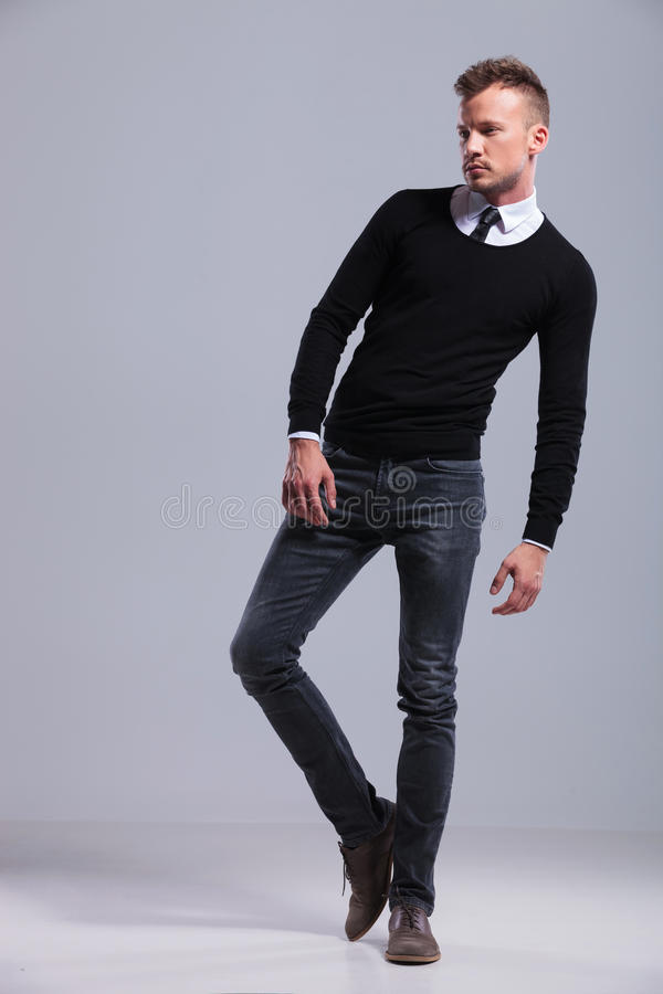 Casual man leans on one leg stock images