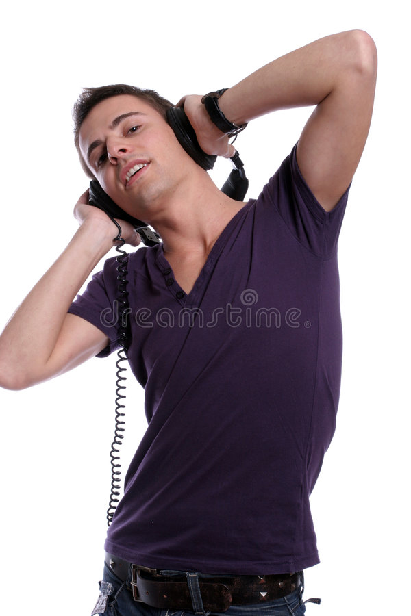 Casual man listening to music royalty free stock images