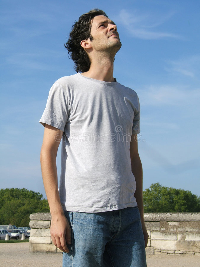 Casual man looking up royalty free stock image