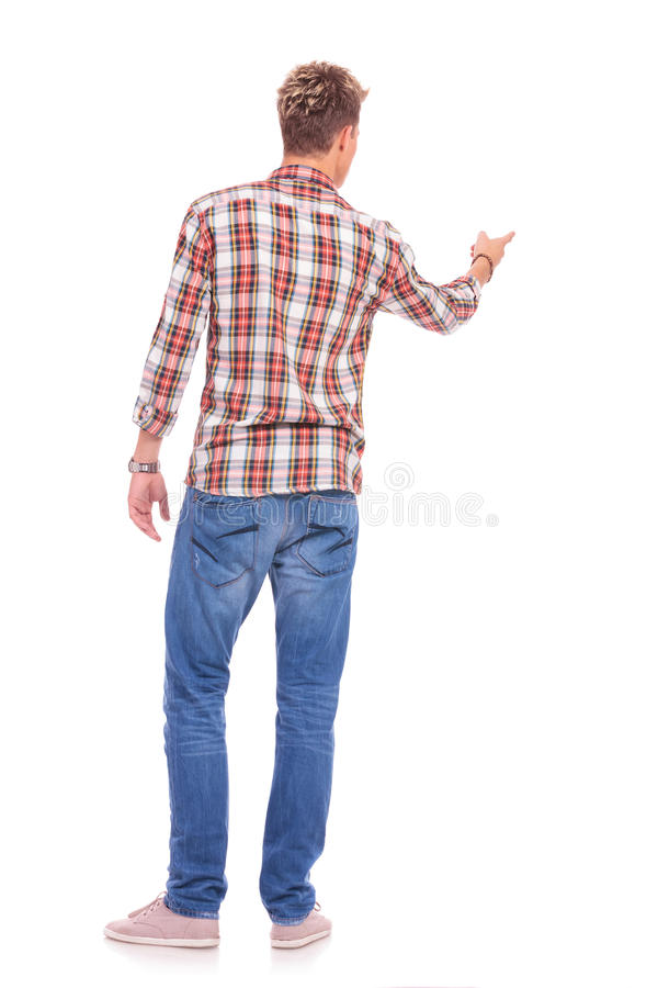 Casual man pointing at something royalty free stock photo