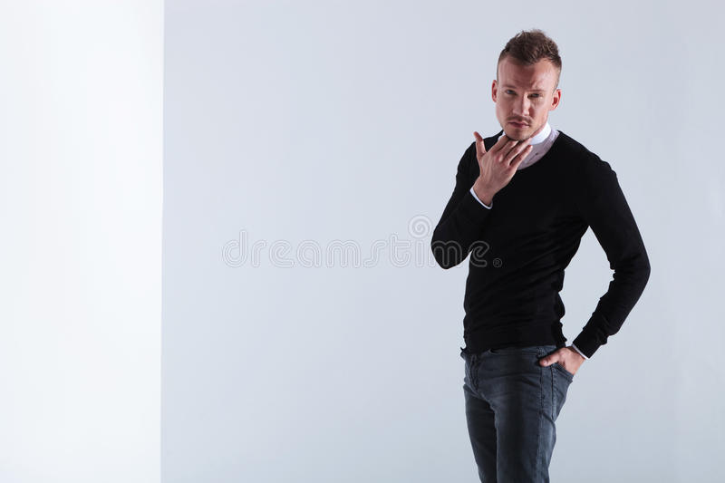 Download Casual Man Scratches His Beard Stock Image - Image: 32413665
