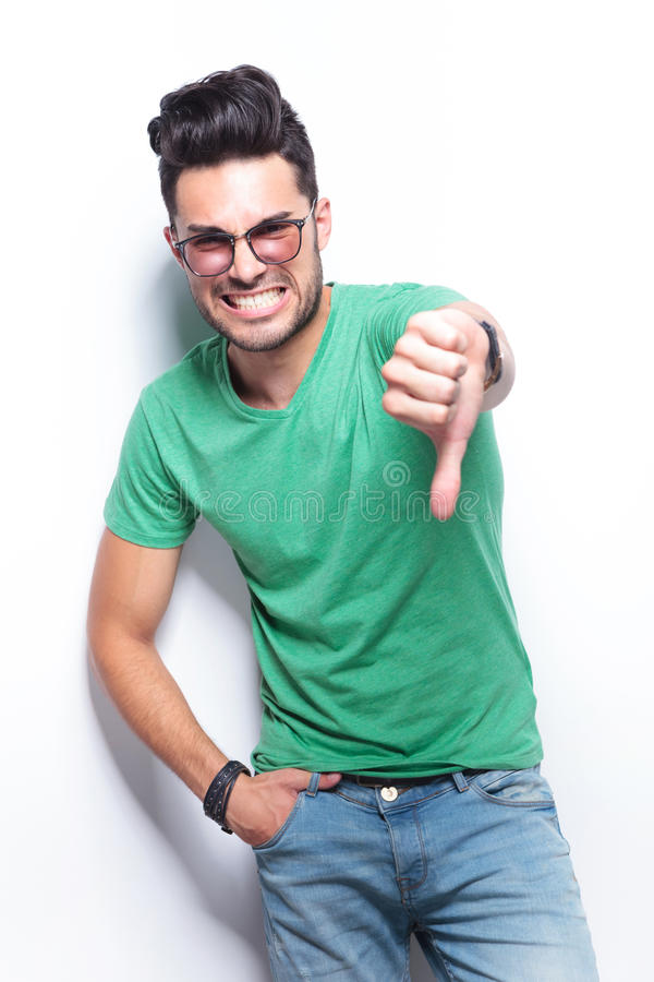 Casual man showing the thumb down gesture stock photos