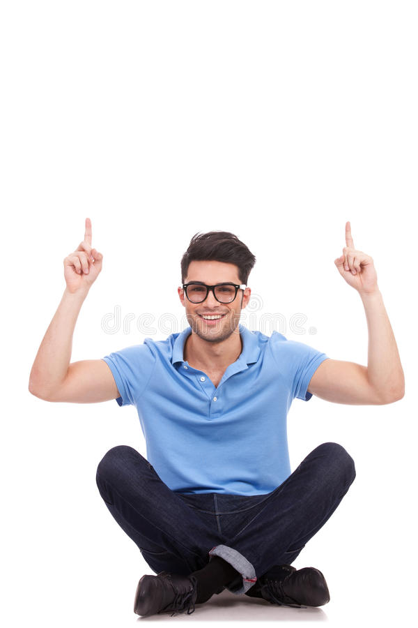Download Casual Man Sitting And Pointing Up Stock Photo - Image: 26964304
