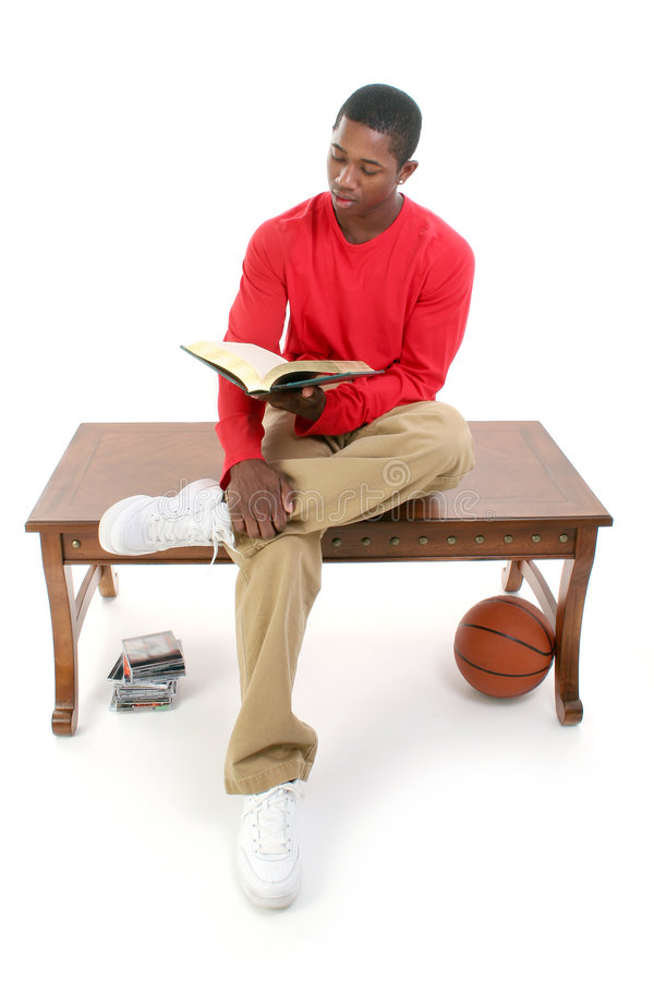 Download Casual Man Sitting On Table Reading Book Stock Photo - Image: 253662