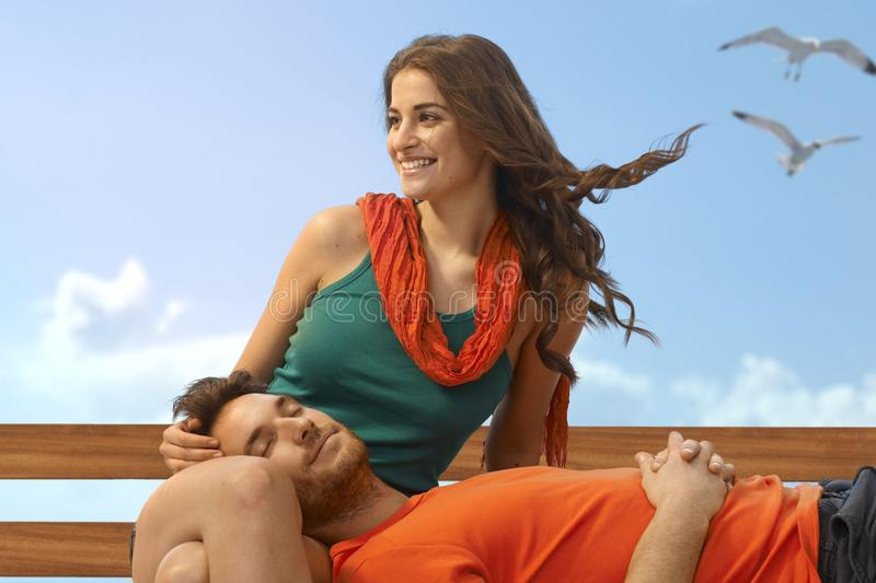 Download Casual Man Sleeping In Lap Of Girlfriend At Beach Stock Image - Image: 40376117