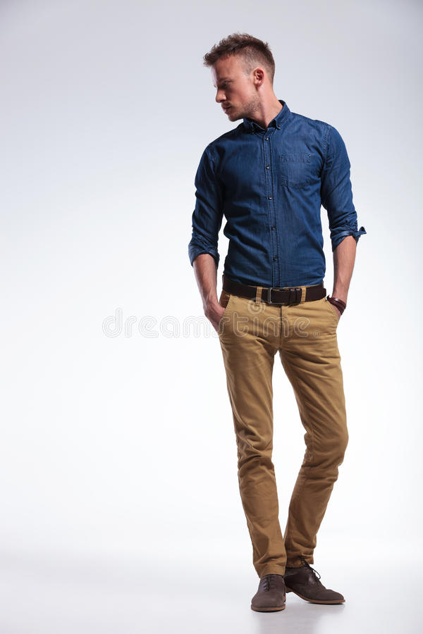 Casual man standing with both hands in pockets