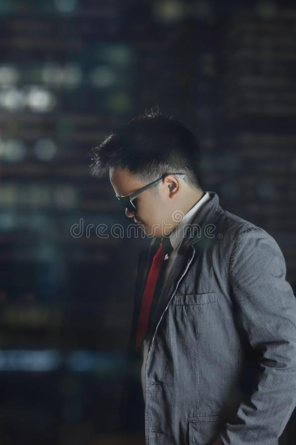 Casual Man With Sunglasses Looks Down. royalty free stock photo
