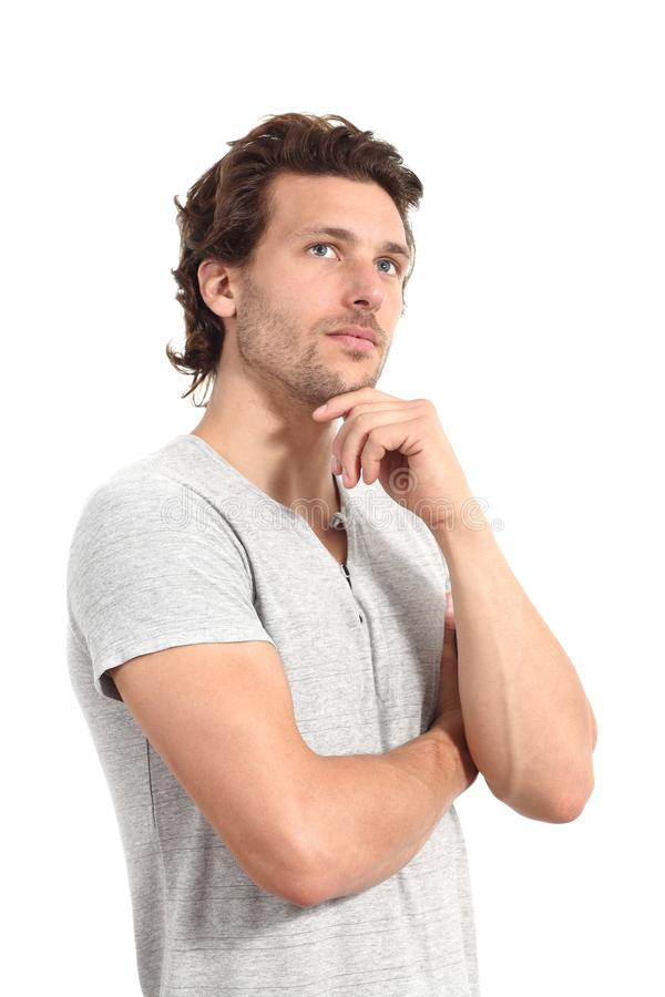 Casual man thinking. With a hand in his chin and a white isolated background stock photography