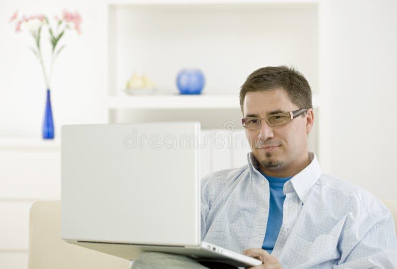 Casual Man Using Laptop Royalty Free Stock Image