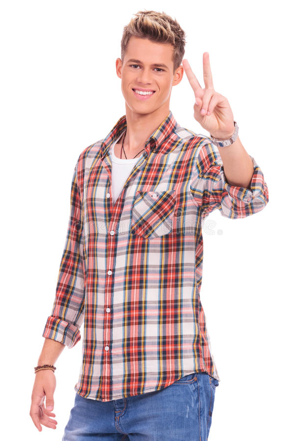 Download Casual man victory sign stock image. Image of smile, studio - 27446185