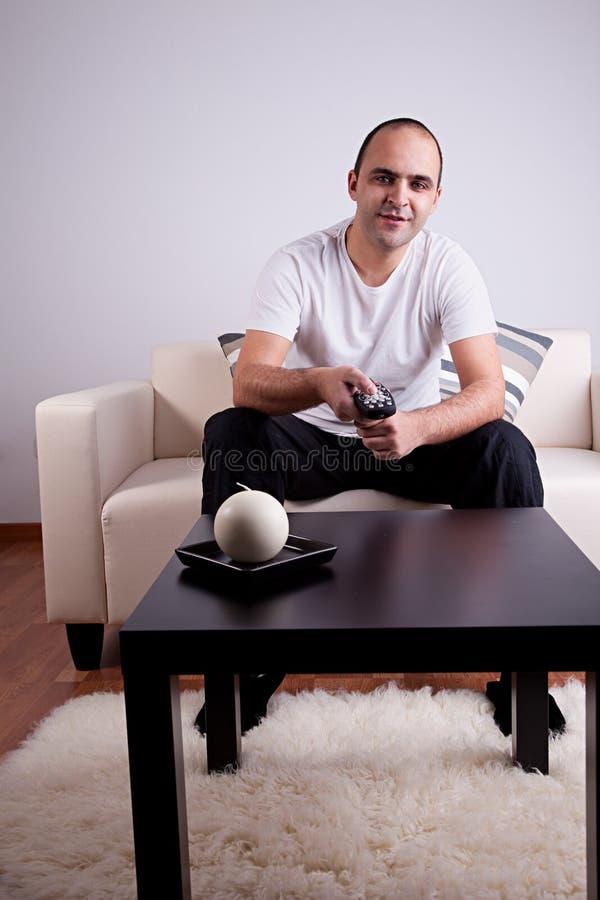 Free Casual Man Watching Tv On Sofa Royalty Free Stock Image - 13771896