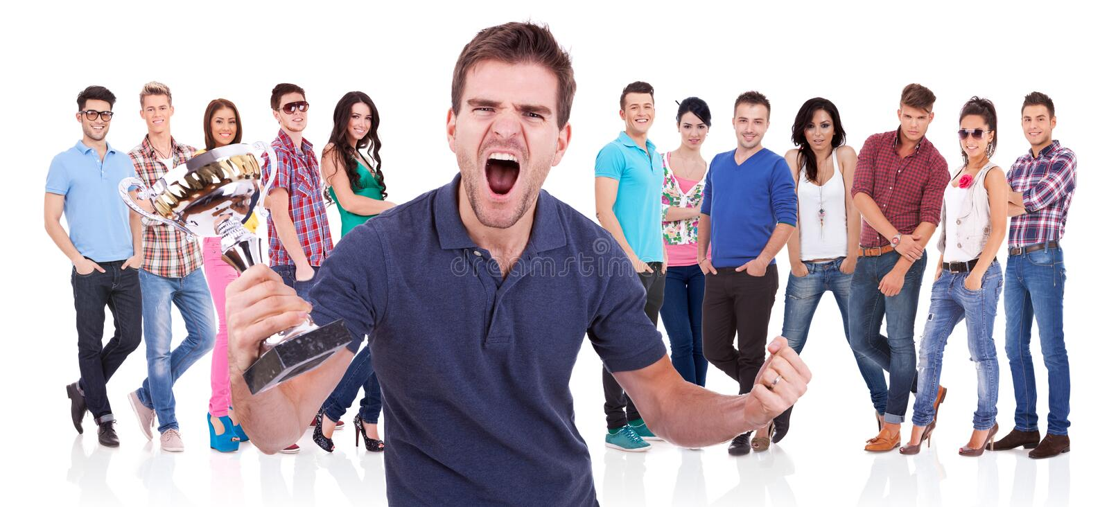 Download Casual Man Winning A Trophy And Screaming Stock Photo - Image: 28782732