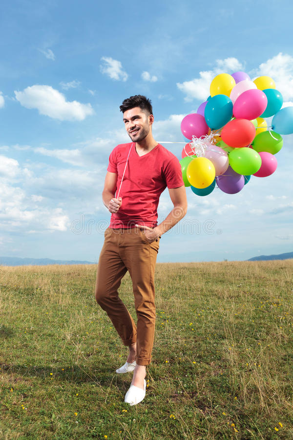 Free Casual Man With Baloons Over His Shoulder Royalty Free Stock Photos - 33178518