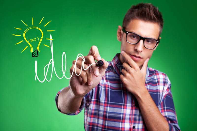 Download Casual Man Wrtiting Idea And Light Bulb Stock Photography - Image: 27446212