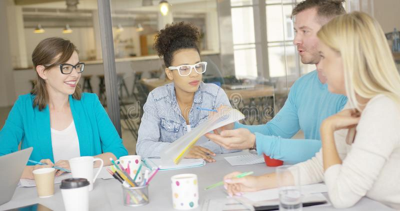 Man sharing documents with coworkers stock photography