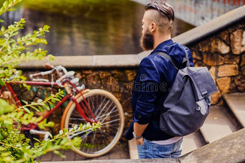 Modern guy with backpack. Back view. royalty free stock photos