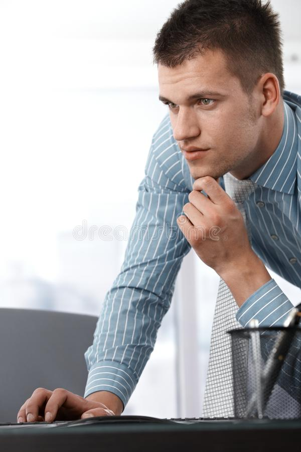 Casual Office Worker Using Computer Royalty Free Stock Photos