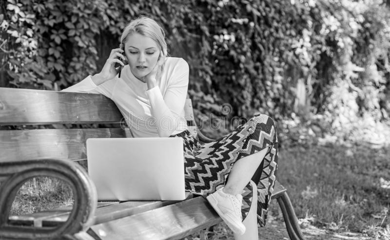 Casual and part time outdoor jobs. Workplace outdoors. Working outdoors. Freelance lifestyle advantages. Girl sit bench. With notebook. Woman with laptop works stock photo