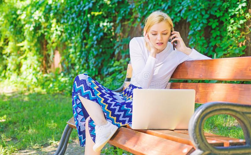 Casual and part time outdoor jobs. Workplace outdoors. Working outdoors. Freelance lifestyle advantages. Girl sit bench. With notebook. Woman with laptop works royalty free stock image