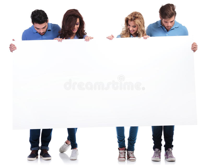 Casual people holding and looking at a blank board stock photos