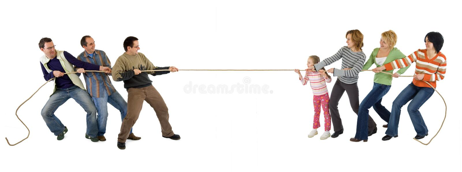 Casual people playing tug of war. Man and woman playing tug of war - isolated stock images