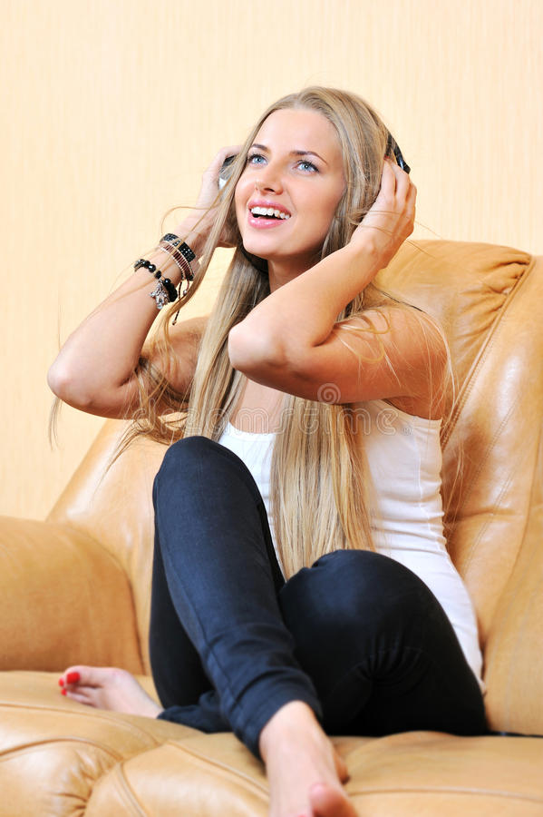 Download Casual Portrait Of A Beautiful Girl Enjoying Music And Smiling Stock Photo - Image: 30107380
