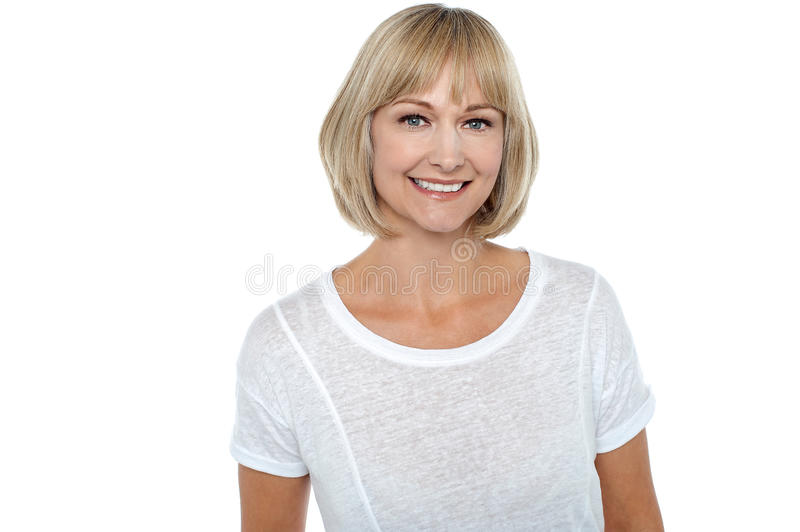 Casual portrait of smiling middle aged woman royalty free stock images