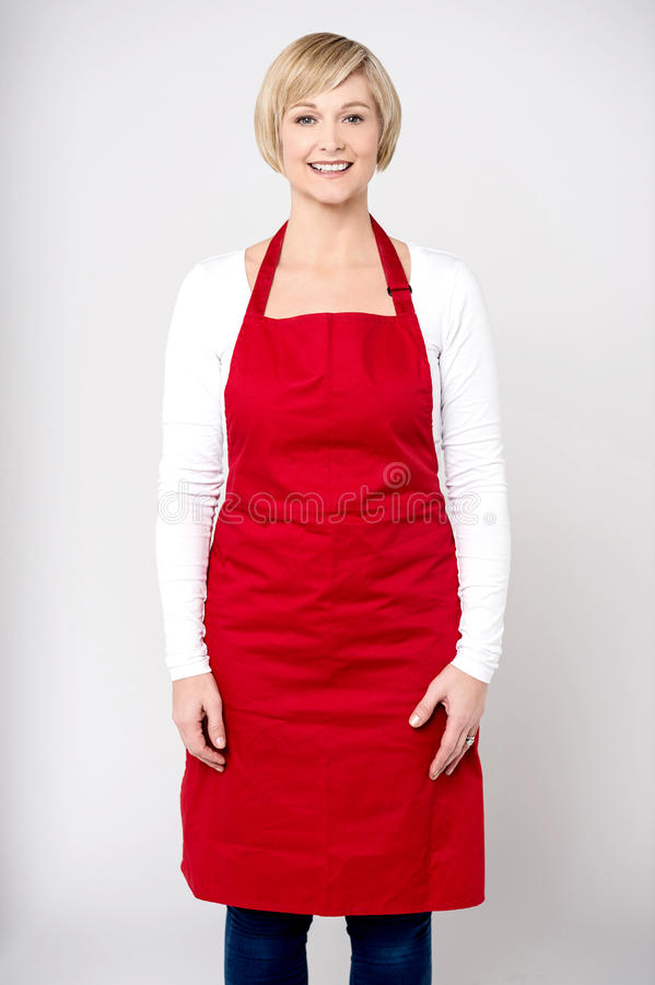 Casual pose of happy female chef royalty free stock image